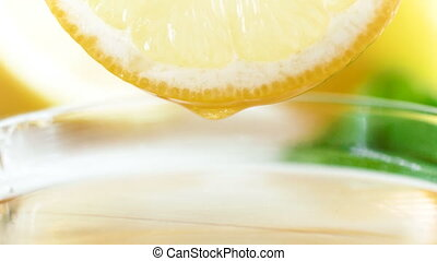 4k closeup footage of fresh juice slowly flowing from lemon...