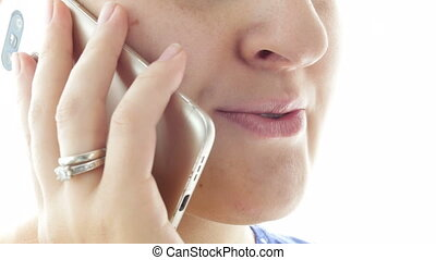 4k closeup footage of woman face while talking by cell phone...