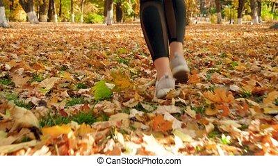 4k closeup video of female feet in sneakers running on ...