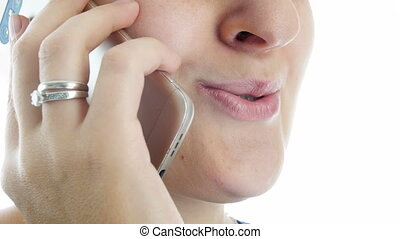 4k closeup video of female mouth talking by phone
