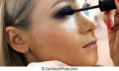 4k closeup video of professional makeup artist applying...