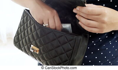 4k conceptual footage of contraception. Young woman taking condom out of her handbag