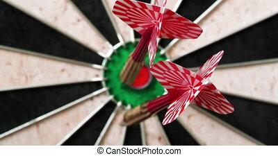 4K - Dart hits the bullseye. Dartboard defocused view