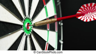 4K - Dart hits the bullseye. Side view