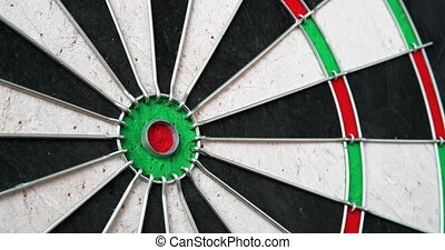 4K - Darts. Dart hits the bullseye