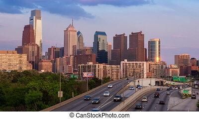 4K Day to Night Timelapse of the philadelphia skyscraper over a cloudy blue sky - Pennsylvania USA