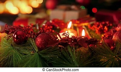 4k dolly video of beautiful advent wreathwith burning candles on Christmas eve. Perfect background or backdrop for Christmas or New Year