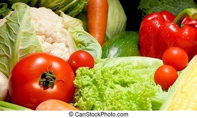 4k dolly video of big assortment of fresh farm vegetables ...