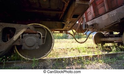 4k dolly video of old rusty cargo train car on abandoned railroad. Concept of transportation and cargo using railways