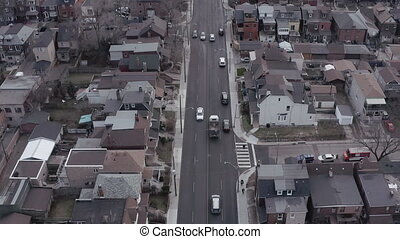 4K Establishing shot of a road in a large city. Aerial...