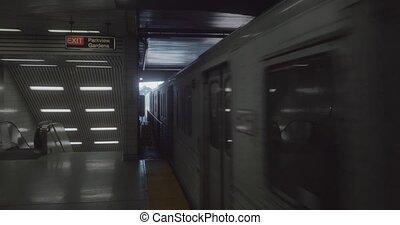 4K Establishing shot of a subway train arriving at the station.