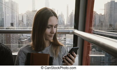4K European tourist female in air tramway cabin. Beautiful...