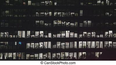 4K Exterior establishing shot of a modern office building at...
