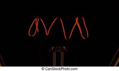 4K - Filament of a light bulb
