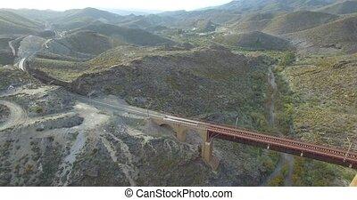 4K Flight over a railroad bridge