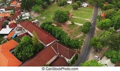 4K flying video of balinese houses on Serangan island, Bali,...