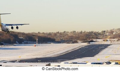 4k footage airplane landing in winter airport, dawn sunrise time