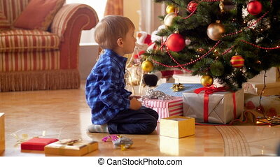 4k footage of 3 years old little boy sitting on floor at...