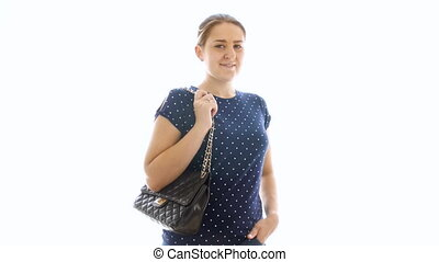 4k footage of beautiful smiling woman in jeans and t-shirt standing against white background