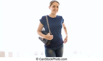 4k footage of beautiful young woman with handback posing against white background