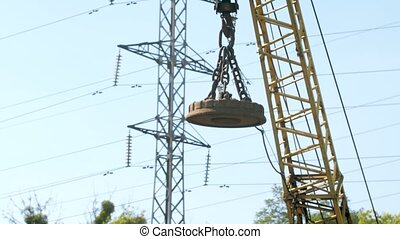 4k footage of big electric magnet hanging on high crane used...