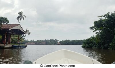 4k footage of boat sailing in the lagoon on river at tropical jungle forest
