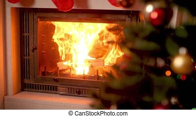 4k footage of burning fireplace next to decorated CHristmas ...