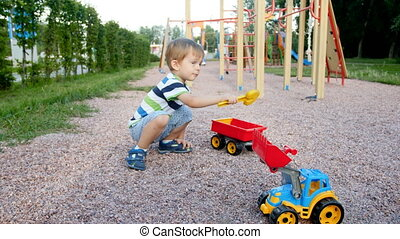 4k footage of cute 3 years boy playing on palyground with...