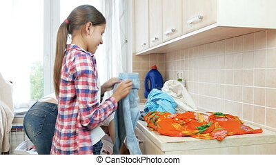 4k footage of cute girl helping her mother sorting and...