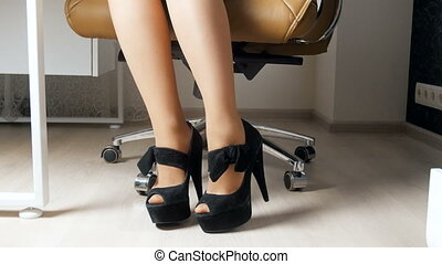 4k footage of elegant businesswoman wearing long heels...