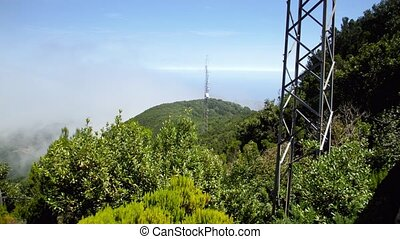 4k footage of high radio or television towers on high ...