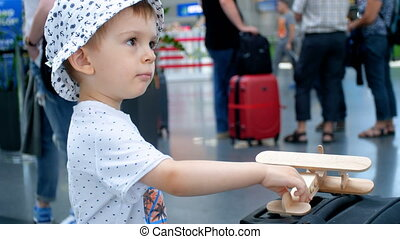4k footage of little toddler boy playing with wooden toy...