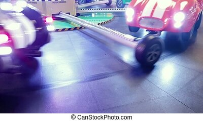 4k footage of spinning child carousel with toy cars at...