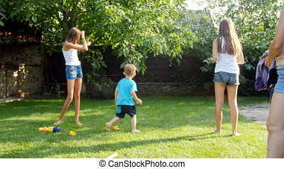 4k footage of two elder sister throwing toy airplane to...