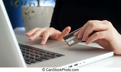 4k footage of woman entering credit card number while doing...