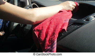 4k footage of young owman cleaning and polishing car...