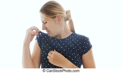 4k footage of young woman closing nose after smelling her...