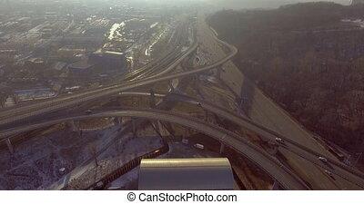 4k footage road transport interchange near the winter forest.