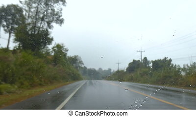 4K Front car view moving on countryside unsmooth road with rain drop and shake