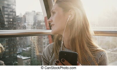 4K Happy Caucasian girl in Island Tramway, NY. Pretty lady...