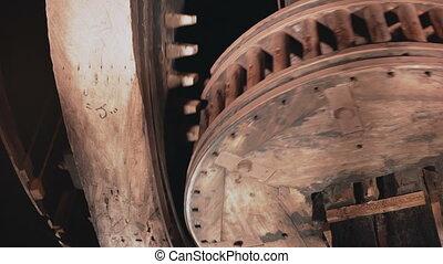 4K Huge wooden cogwheels spin together close-up. Traditional...