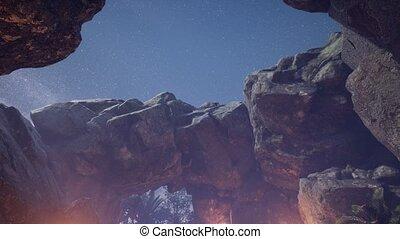 4K hyperlapse astrophotography star trails over sandstone...