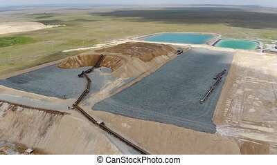 4k Industrial quarry for the extraction of gold, processing and cleaning of minerals. Aerial view