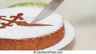 4K - Knife cuts off a piece of almond cake