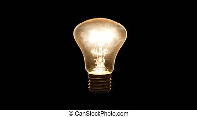 4K - Lights up incandescent light bulb