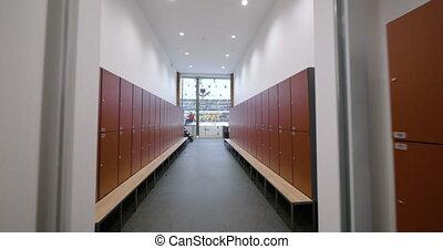4K - Motion across hockey sports center hallway