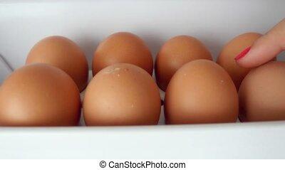 4k of Women hand Open fridge filled and taking a fresh eggs...