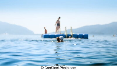 4k out of focus footage of people relaxing on floating...