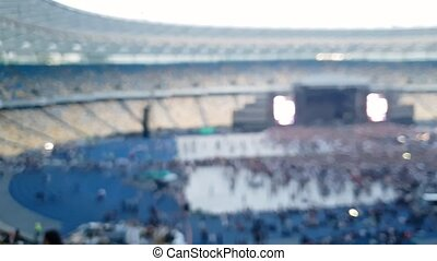 4k out of focus panning video of crowd of fans in fan zone...