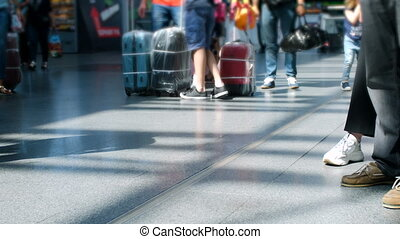 4k out of focus video of passengers feet and suitcases on...